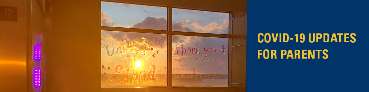 Sunrise through a window at Mott Children's Hospital with the text 'COVID-19 Update for Parents