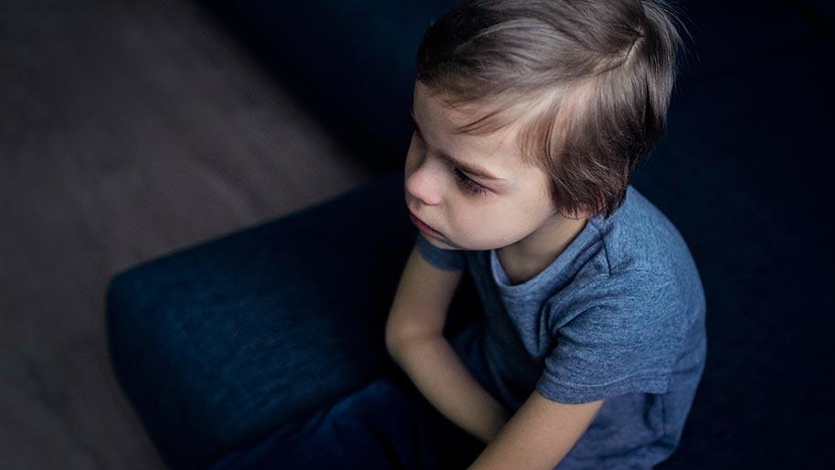 Little boy looking sad