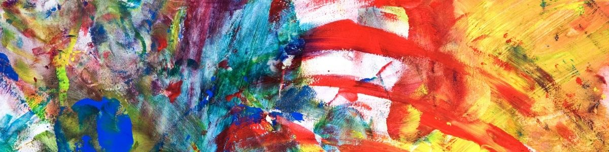 Child's fingerpainting in primary colors
