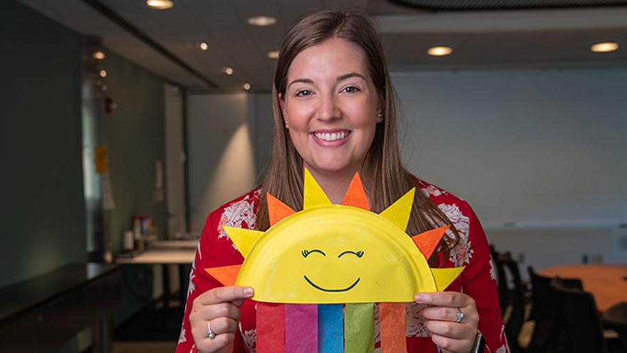 Woman holding a rainbow sun plate