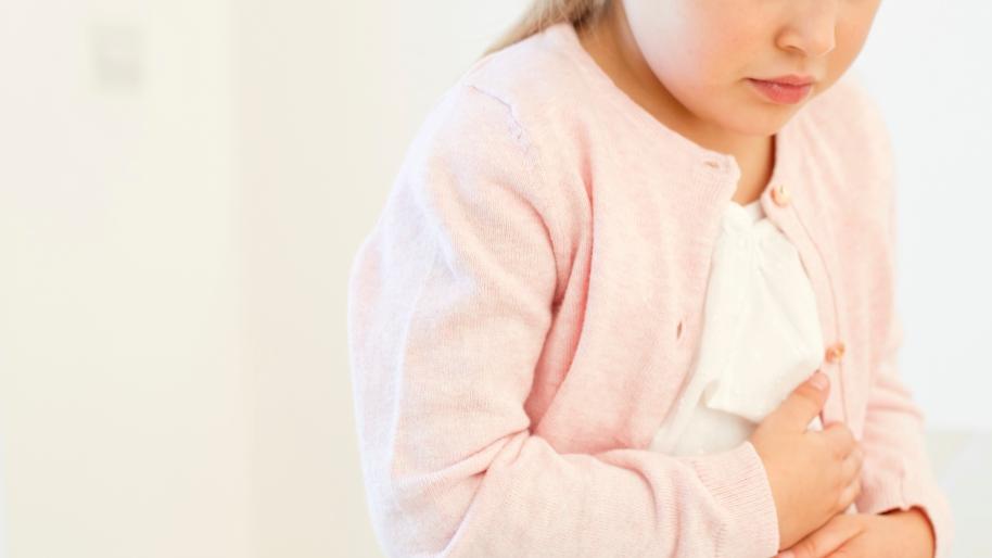 Little girl holding her tummy