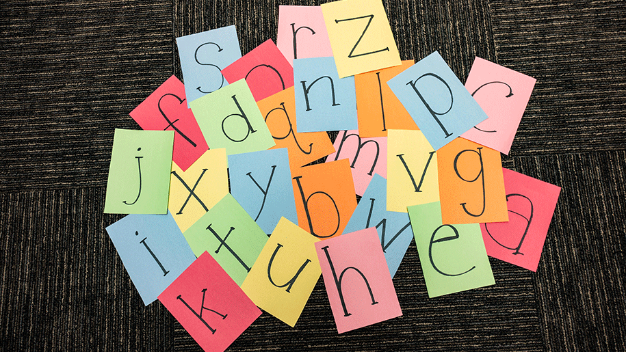 Paper squares with black letters