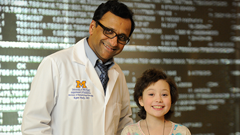 Dr. Rajen Mody with a young female patient