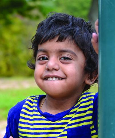 A young U-M patient smiling at the playground.
