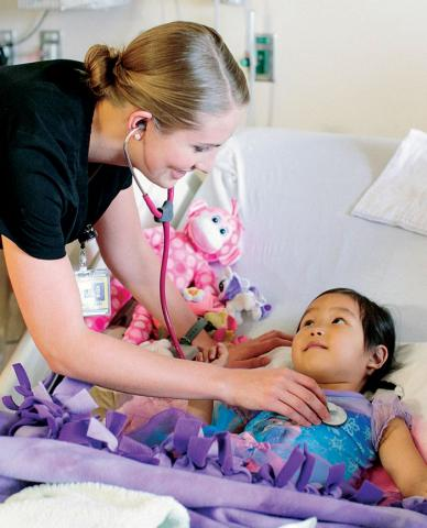 Nurse checking on a young patient