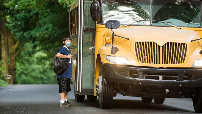 Kid going to school during COVID pandemic