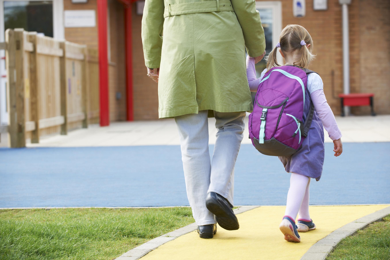 Mom taking child to preschool